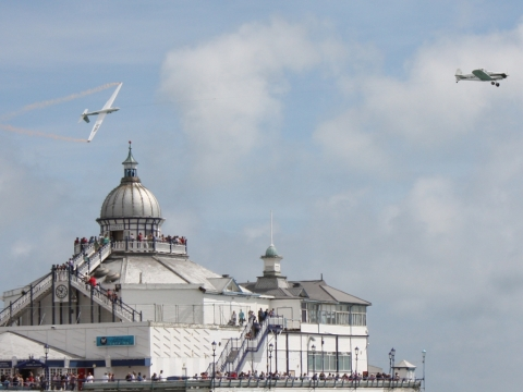 The aerobatic glider looping over Eastbourne Pier