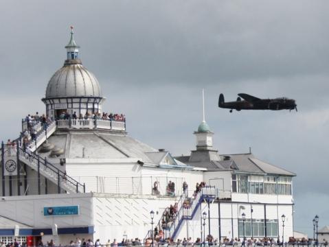 Lancaster bomber over Eastbourne Pier